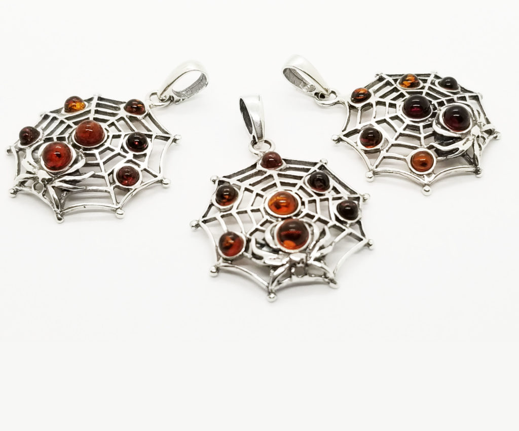 Spider on a Cobweb Cognac Amber Pendant.