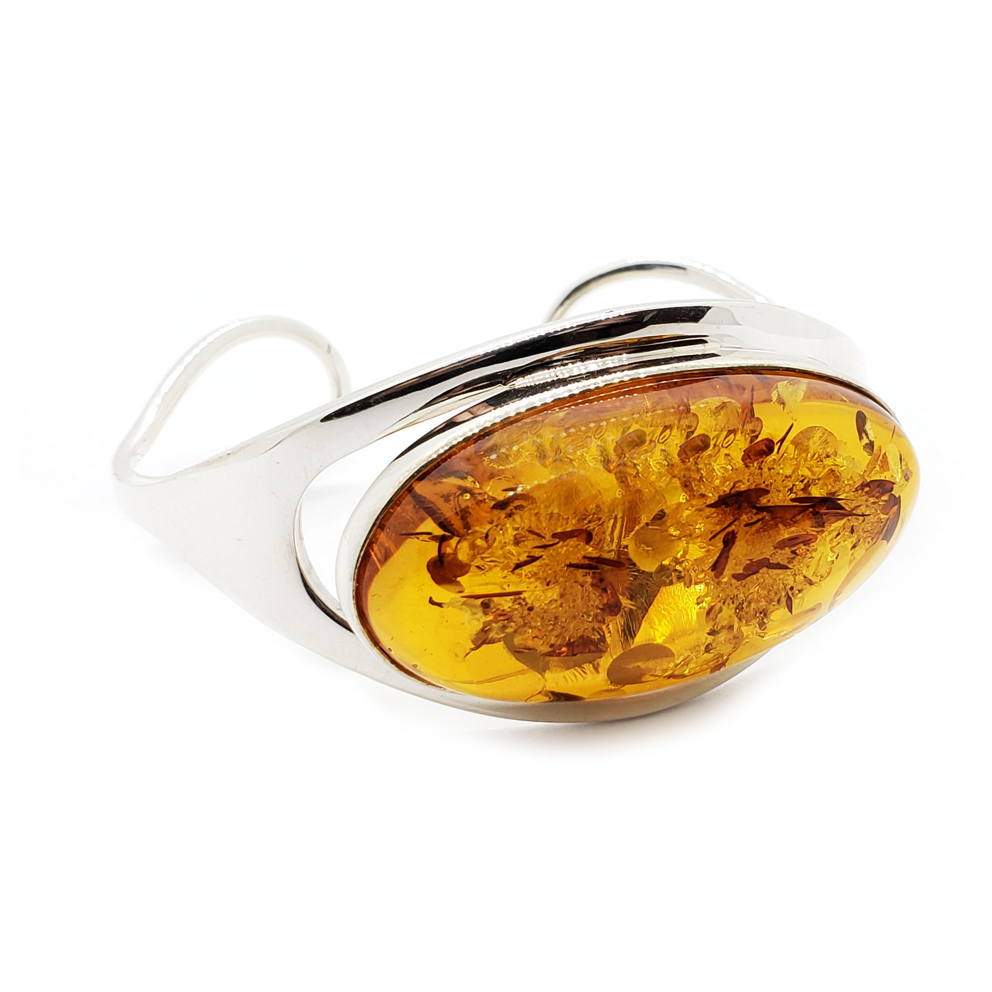 Cognac Baltic Amber Sterling Silver Cuff Bracelet. Oval shaped amber stone set in .925 sterling silver. Open cuff bracelet. IMPORTANT!!! Bracelets are handmade. The product picture may display minor variations to the actual stone, due to the composition and natural properties of gemstones.